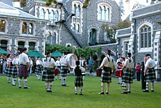 Stock footage of a pipe band playing in a military tattoo