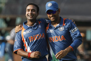 Amit Mishra celebrates with captain Mahendra Singh Dhoni after taking the wicket of West Indies' David Bernard (Reuters)
