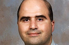 Nidal Malik Hasan was charged Thursday with 13 counts of premeditated murder in a military court (Reuters)