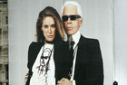 Karl Lagerfeld on a poster with Erin Wasson (Reuters)
