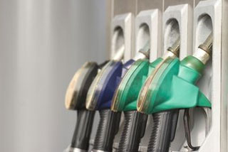 At the pump, retail gas prices fell by less than a penny overnight to a new national average of US$2.594 a gallon