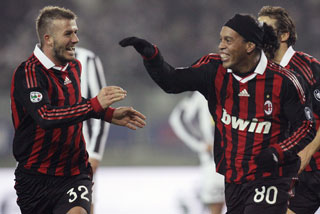 Ronaldinho celebrates with his teammate David Beckham after scoring (Reuters)