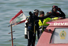 Members of the Lebanese Civil Defence prepare to dive off the coast of Khaldeh (Reuters)