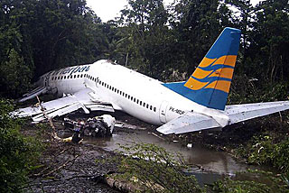 A Merpati Boeing 737-300 lies skidded off on the runway in Rendani airport in Manokwari of the Indonesia's West Papua province (Reuters)