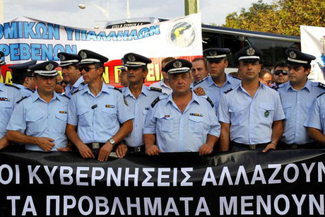Greek policemen hold a banner during an anti-government rally in northern Thessaloniki (Reuters)