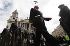 Veterans march past St Paul's Cathedral as a World War II Lancaster bomber flies over head after a service to mark the 70th anniversary of the begining of the Blitz (Reuters)