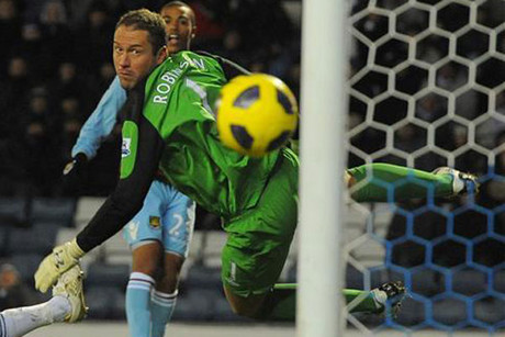 West Ham United's Junior Stanislas (top) shoots to score against Blackburn Rovers (Reuters)