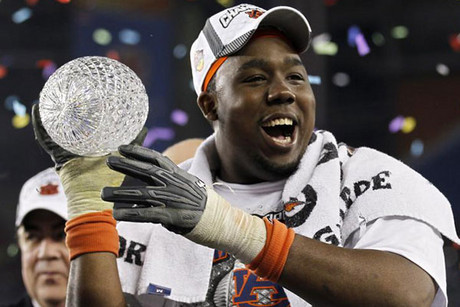 Auburn cpatain Nick Fairley with the trophy (Reuters)