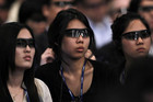 Participants wearing 3D movie glasses watch the movie Avatar (Reuters)