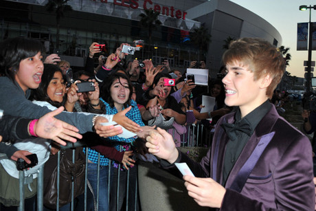 Justin Bieber with fans at the LA premiere of his film Never Say Never (Getty)