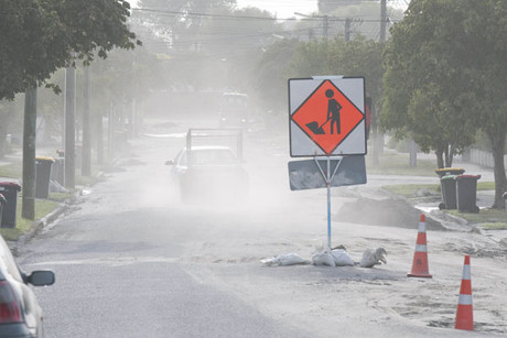 Dust from silt blows about in Mundy's Road, Dallington (NZPA)