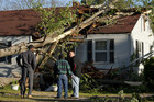 Residents look at a tree that fell into a home in Raleigh (Reuters)