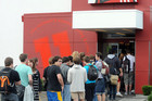 People line up outside KFC restaurants for the controversial burger