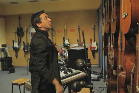 Shihad frontman Jon Toogood visits the music room at his old Wellington high school