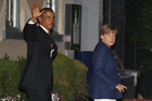 Barack Obama walks out of restaurant with Angela Merkel in Washington (Reuters)