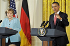Obama at an appearance with visiting German Chancellor Angela Merkel (Reuters)