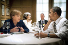 German Chancellor Angela Merkel speaks to US President Barack Obama during a private dinner at the 1789 restaurant in Washington (Reuters)
