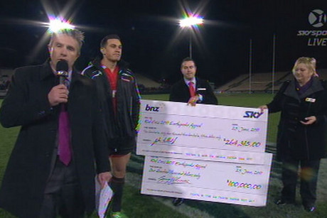 Justin Marshall and Sonny Bill Williams hand over the cheques