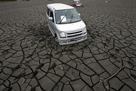 The earthquake and tsunami destroyed around 300,000 cars in Japan (Reuters)