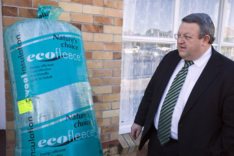 Energy and Resources Minister Gerry Brownlee eyes up home insulation (NZPA)