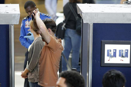 A man is screened with a backscatter x-ray machine at a TSA security checkpoint (Reuters)