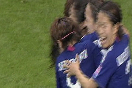 Japan celebrates their late equaliser