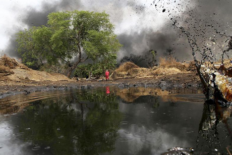 Crude oil spills from a pipeline in Dadabili, Niger state (Reuters)