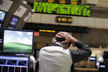 A trader reacts to falling share prices (Reuters)