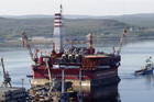 A floating oil platform is tugged from harbour in Russia's northern port of Murmansk - set to launch an Arctic oil exploration effort (Reuters)