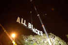 The ALL BLACKS sign was lifted into place by a crane last night
