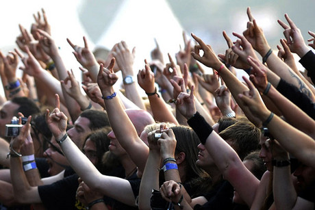 Metal fans show off their horns (Reuters)