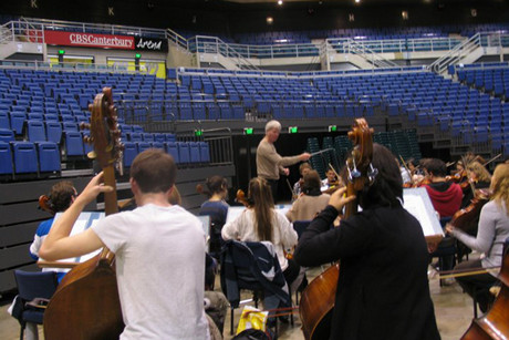 NYO chief executive Peter Walls conducts a rehearsal in the CBS Arena, Christchurch