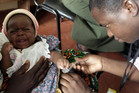 A child is given an injection as part of a malaria vaccine trial (Reuters)