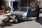 Iraqi soldiers search a vehicle at a checkpoint in Baghdad on Sunday, but could not prevent a suicide bombing today (Reuters)