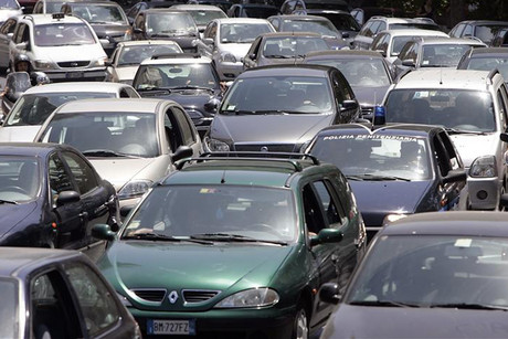 Cars are seen stuck in a traffic jam in downtown Rome (Reuters)