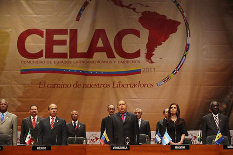 Latin American leaders, including Hugo Chavez, stand during the CELAC summit