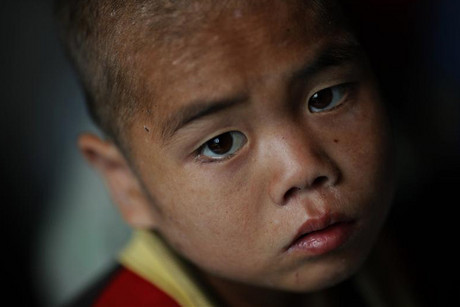 A North Korean child waits to be examined for possible signs of malnutrition in an orphanage in North Korea (Reuters file)