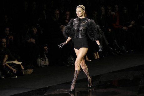 Kate Moss presents a Marc Jacobs creation as part of his Fall-Winter 2011/2012 collection for Louis Vuitton (Reuters)