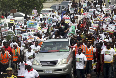 Members of the Niger Delta People Volunteers Force march in support of Nigeria's President Goodluck Jonathan on fuel subsidies removal in the oil hub city of Port Hacourt (Reuters)
