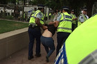 Police detain Occupy protestor Penny Bright at Auckland's Aotea Square