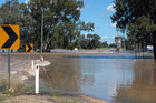 The Balonne river floods the St George weir (AAP)
