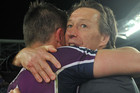 Melbourne Storm's coach Craig Bellamy (right) and Cooper Cronk celebrate their win (AAP)