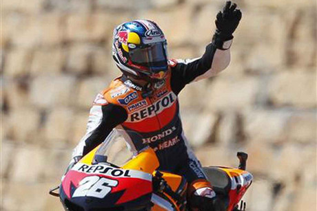 Dani Pedrosa salutes his win to the crowd (Reuters)