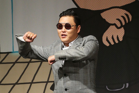 Psy performs his famous dance at a press conference in South Korea (AAP)