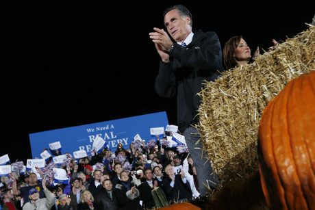 Republican presidential nominee Mitt Romney claps as he arrives at a campaign rally outside the Cuyahoga Falls Natatorium in Cuyahoga Falls, Ohio (Reuters/Shannon Stapleton)