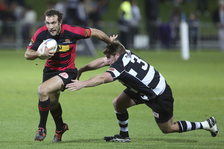Canterbury's Adam Whitelock steps through the tackle of Hawkes Bay's Peter Borlase (Photosport)