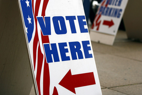 Voting signs sit outside the Licking County Board of Elections on the first day of early voting in Newark, Ohio (Reuters/Matt Sullivan)