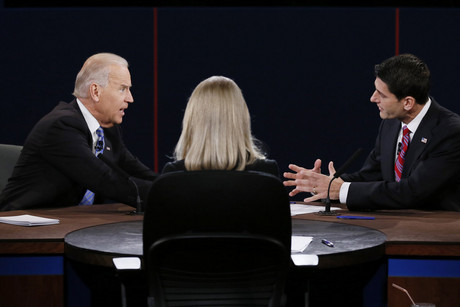 US Vice President Joe Biden (L) and Republican vice presidential nominee Paul Ryan discuss a point in front of moderator Martha Raddatz (C) during the vice presidential debate in Danville, Kentucky