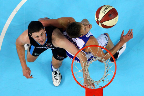 The Breakers Alex Pledger battles it out with Adelaide's Daniel Johnson (Photosport)