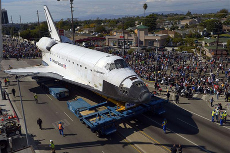 The space shuttle Endeavour is slowly moved along city streets in Los Angeles, California (Reuters)